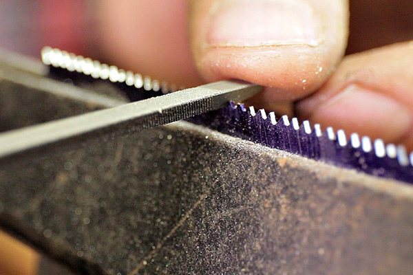 Handsaw Blades being sharpened