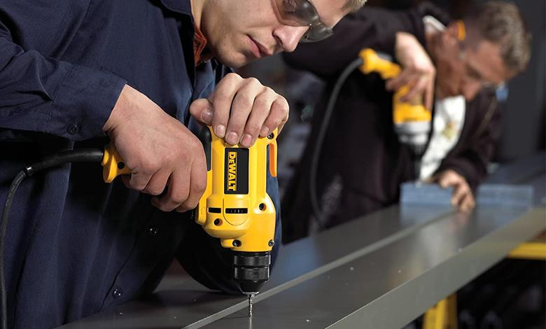 drilling a metal frame with DEWALT VSR Electric Drill (DWD112)