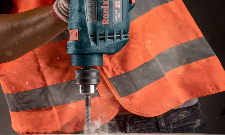 Hammer drill used to drill concrete block