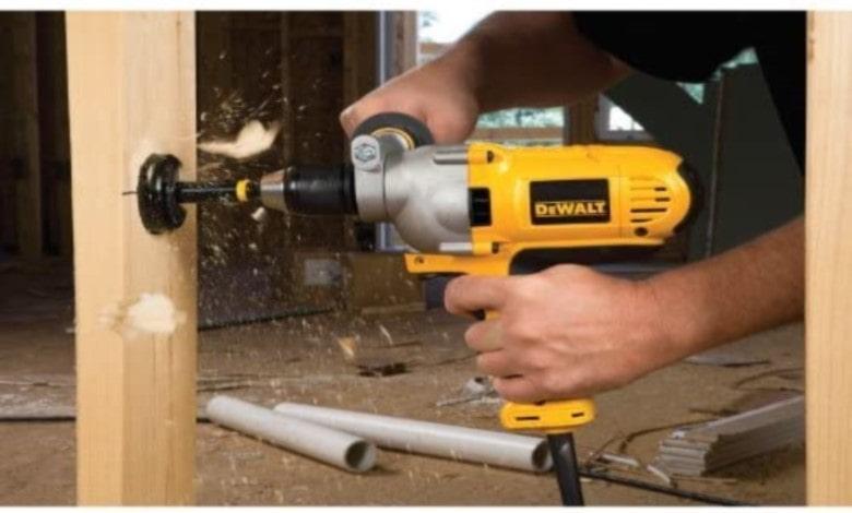 DeWalt corded drill, drilling into wood